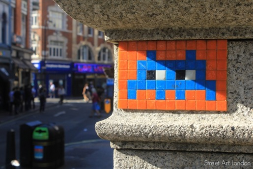 Mosaic street art mural by Invader