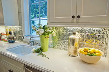 Splashback featuring tin tiles from Andy Thornton