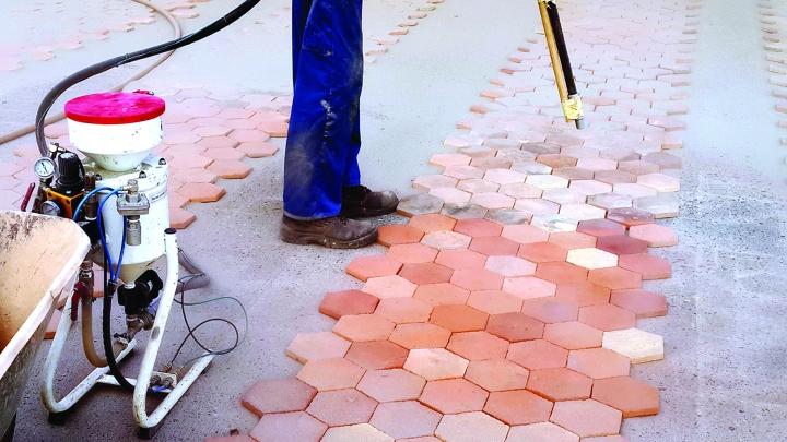 Sandblasting the tiles