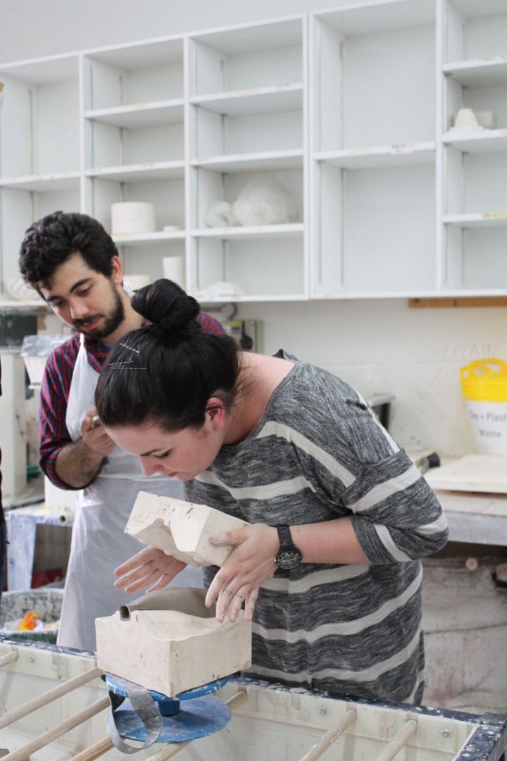 student Nojan Adami and an instructor casting a ceramic cone for the ceiling installation that will feature at RIBA North's new show