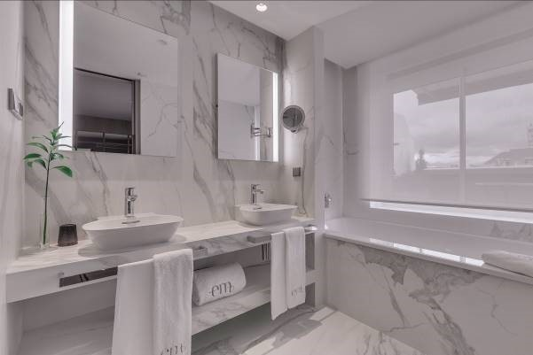 This en-suite bathroom at the Hotel Emperatriz, Madrid, features Neolith surface solutions