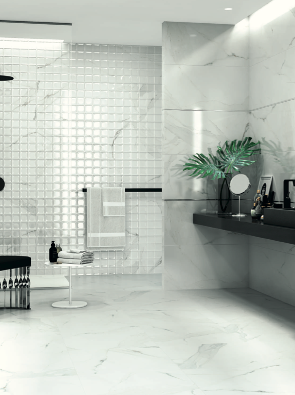 Marbox Calacatta Square and Altair Silver Lista wall tiles, and Marbox Calacatta Natural floor tiles, by Aparici