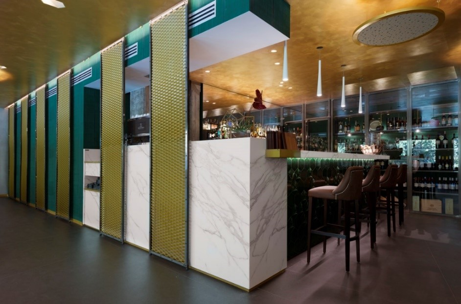 Il Lusso Della Semplicita; Bar Worktop and stairs Neolith Calacatta Silk; Floor Neolith Nero Zimbabwe