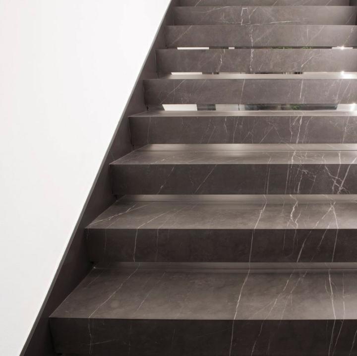GranitiFiandre HQ stairwell featuring Marmi Maximum in Pietra Grey