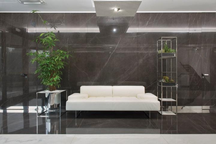 GranitiFiandre HQ waiting area featuring Marmi Maximum in Pietra Grey